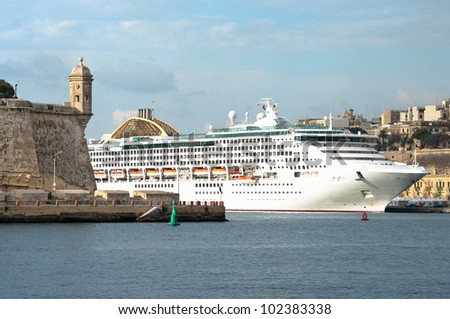 watchtower and cruise ship in the Grand Harbour in Valletta, Malta