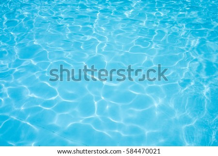 Water abstract background, Swimming pool rippled. - Shutterstock ID 584470021