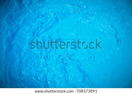 Water and air bubbles over blue background,sea wave ,Bokeh light background in the pool,Hotel swimming pool with sunny reflections. #708373891