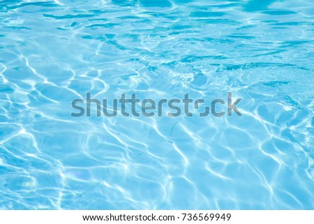 Water background, Hotel swimming pool with sunny reflections #736569949