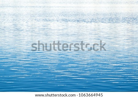 water background: shallow ripples on the surface of a blue lake Photo stock ©