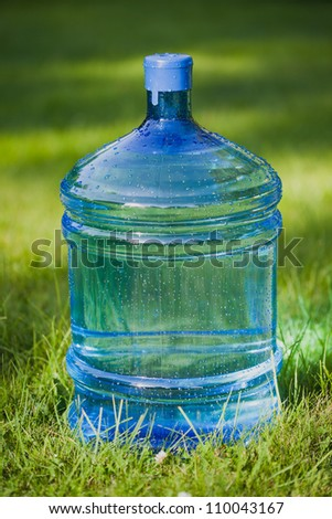 water big bottle on green grass background