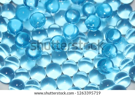 Water blue gel balls. Polymer gel. Silica gel. Balls of blue hydrogel. Crystal liquid ball with reflection. Texture background. Close up macro #1263395719