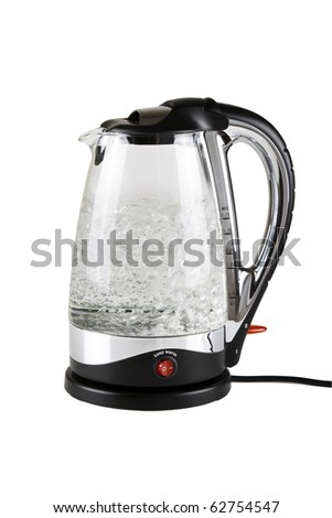 Water boiling in the glass electric kettle.