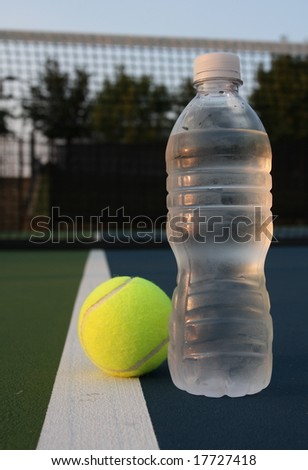 Water bottle and a tennis ball, health