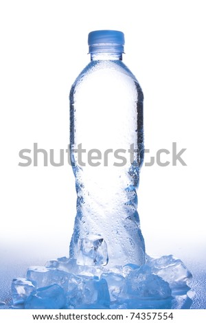 water bottle on white shot in high key copy space in center of bottle with ice, reflection and water droplets in gradient, cool blue tone