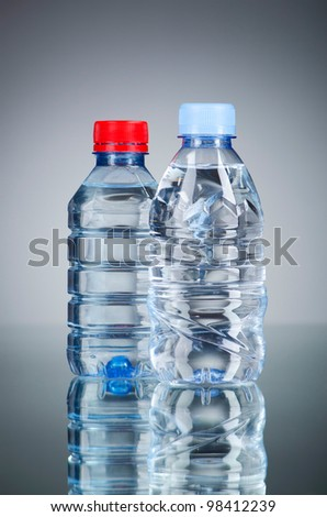 Water bottles as healthy drink concept - stock photo