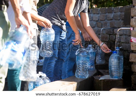 Water bottles being filled with Spring water at Newlands Spring Water Cape Town South Africa #678627019