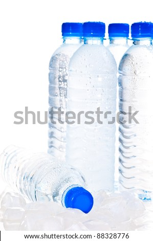 Water bottles on ice over white background - stock photo