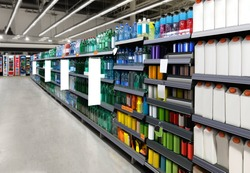 Water bottles on shelf in supermarket suitable for presenting new water bottles and packaging among many others.