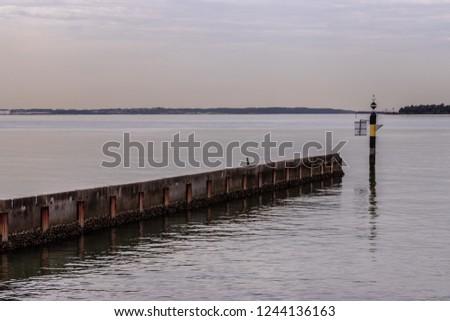 Water break and navigation marker at Dolls Poiunt, Australia, Botany Bay. #1244136163