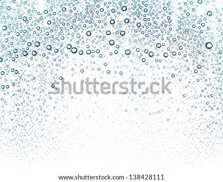 Water bubbles in a glass container close up
