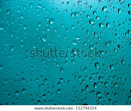 Water bubbles or Raindrops on blue background. Water drops.