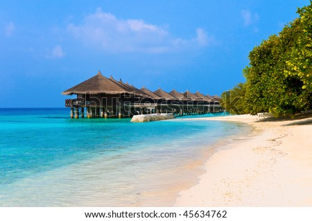 Water bungalows on a tropical island - travel background