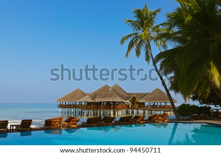 Water cafe and pool - Maldives vacation background #94450711