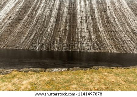 Water cascades down the Derwent Dam, Ladybower reservoir. Near Sheffield, in Peak District, Derbyshire, England, United Kingdom. #1141497878