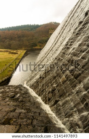 Water cascades down the Derwent Dam, Ladybower reservoir. Near Sheffield, in Peak District, Derbyshire, England, United Kingdom. #1141497893