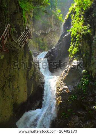 Water cascades falling through a rocky pass