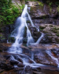 Water cascades over High Shoals Waterfall in Hiawassee, Georgia.