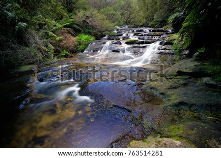 Water cascading down the rock formations at Leura Cascades, Blu Mountains, NSW, Australia                                #763514281