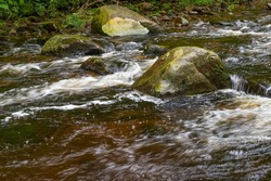 water cascading over a rock in willard brook locrted at willard brook state forest in townsend