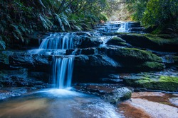 Water cascading over rocks early in the morning in Leura Cascades, New South Wales, Australia