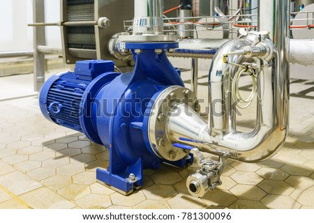 Photo of  Water Centrifugal pump and motor line with pipe rack in power plant construction site industrial, demineralized water