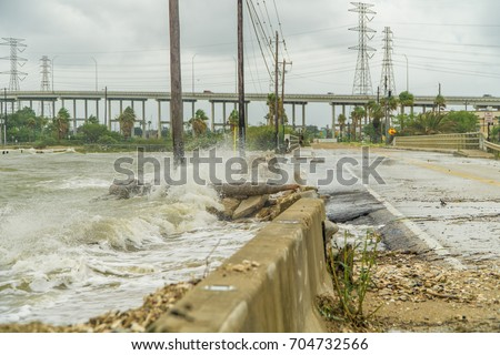 Water coming over the road in Kemah during Hurricane Harvey   #704732566