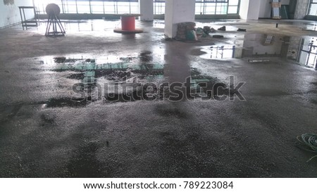 Water curing of floor finishes.Cement sand screed curing work
