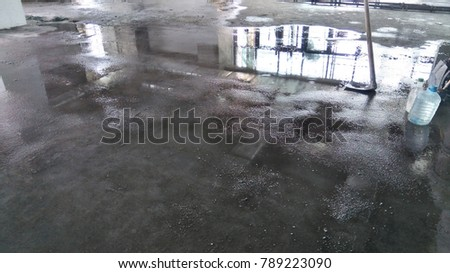 Water curing of floor finishes.Cement sand screed curing work.