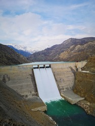 water dam in mountains. dam gates. electricity generation