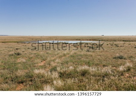 Water Dam in the Veld in the dry Northern Cape landscape of South Africa Stockfoto ©