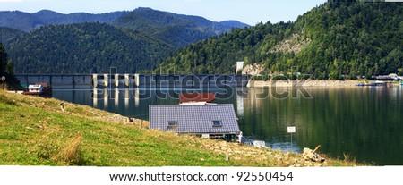 Water dam on a lake ,Romania