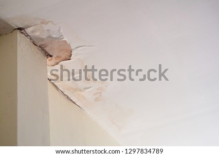 Water damaged ceiling roof, brown stain, office building