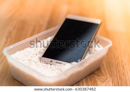 Shutterstock Water damaged phone in rice