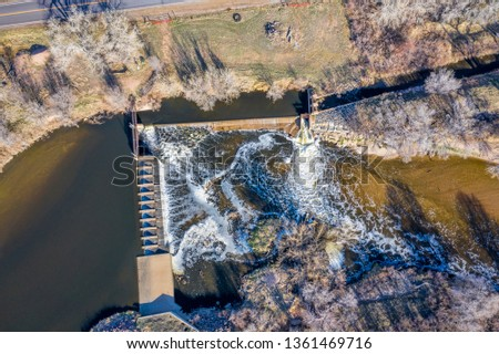 water diversion dam on the South Platte River abover Brigthon, Colorado - aerial in early spring scenery #1361469716