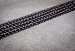 water drain or ditch on the road. Gutters drain grate, drain cover. Road drains - sewer cover. iron grate of water drain on the road in every city. Water go down to the drain on the road.