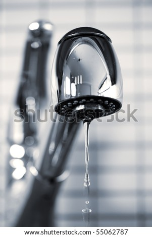 Water dripping from stainless steel kitchen faucet