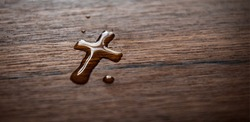 Water drop cross on wood
