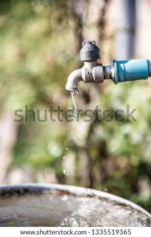 Water drop flowing from faucet, Thailand. #1335519365