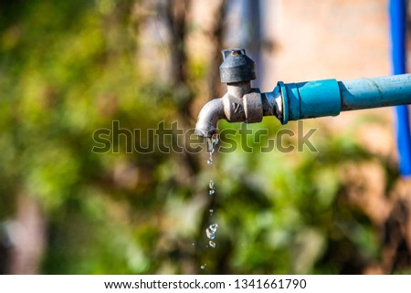 Water drop flowing from faucet, Thailand. #1341661790