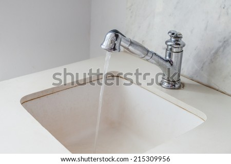 Water drop from faucet white modern white sink
