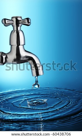 water drop from metal tap
