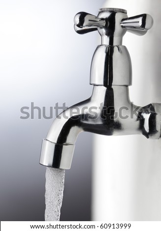 water drop from metal tap - stock photo