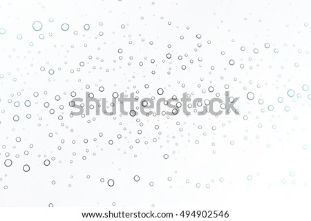 Water drop on glass background.