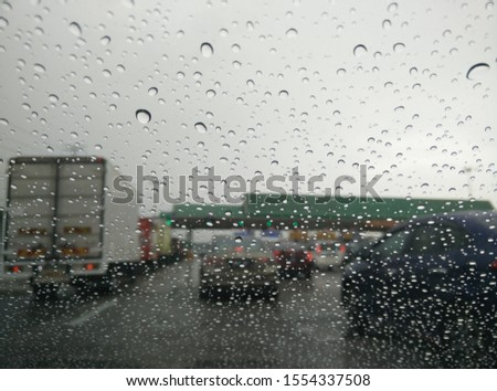 water droplet during heavy rain and heavy traffic. View from inside the car