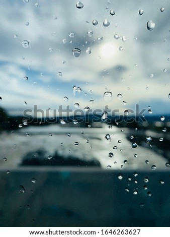Water droplets adhering to glass after rain