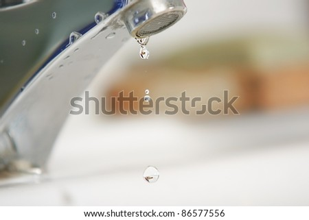 Water droplets at faucet