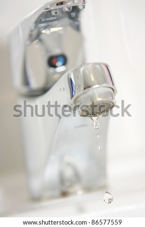 Water droplets at faucet