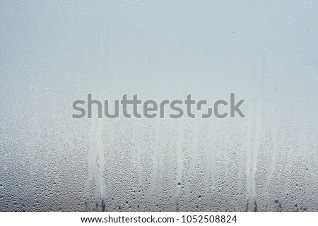 Water droplets condensation background of dew on glass, humidity and foggy blank. Outside , bad weather, rain